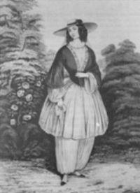 XIX-wieczna kobieta, nosząca bloomersy pod warstwą krótkiej spódnicy
